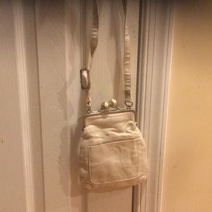 Handbags - Nwot gold cross body bag never used super cute
